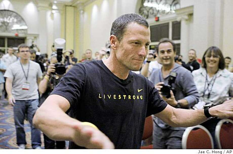 Cyclist Lance Armstrong arrives for a news conference at the annual Interbike International Bicycle Expo in Las Vegas, Thursday, Sept. 25, 2008. (AP Photo/Jae C. Hong) Photo: Jae C. Hong, AP