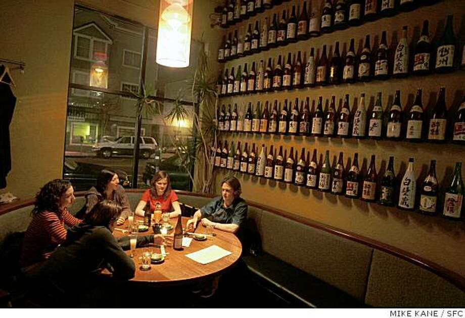 Patrons partake in sushi and drinks at Tsunami Sushi & Sake Bar in the Western Addition Photo: MIKE KANE, SFC