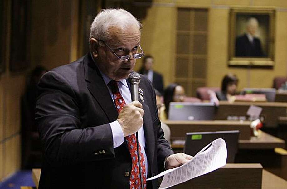 Arizona state Sen. Russell Pearce, R-Mesa, talks about why he is voting for SB1070 during a vote on a new immigration bill Monday, April 19, 2010, in Phoenix.  Arizona lawmakers approved a sweeping immigration bill Monday intended to ramp up law enforcement efforts even as critics complained it could lead to racial profiling and other abuse.  The state Senate voted 17-11, with two not voting,  nearly along party lines to approve the measure. Photo: Ross D. Franklin, AP