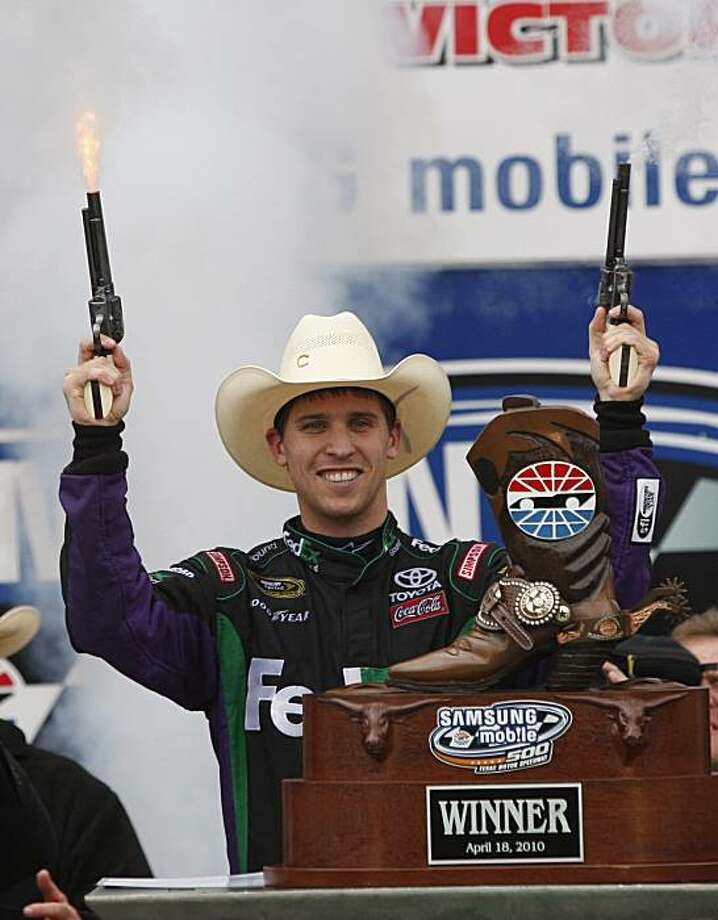 Denny Hamlin (11) fires commemorative pistols in Victory Lane after winning the NASCAR Samsung Mobile 500 race at Texas Motor Speedway in Fort Worth, Texas, Monday, April 19, 2010. (Ron T. Ennis/Fort Worth Star-Telegram/MCT) Photo: Ron T. Ennis, MCT