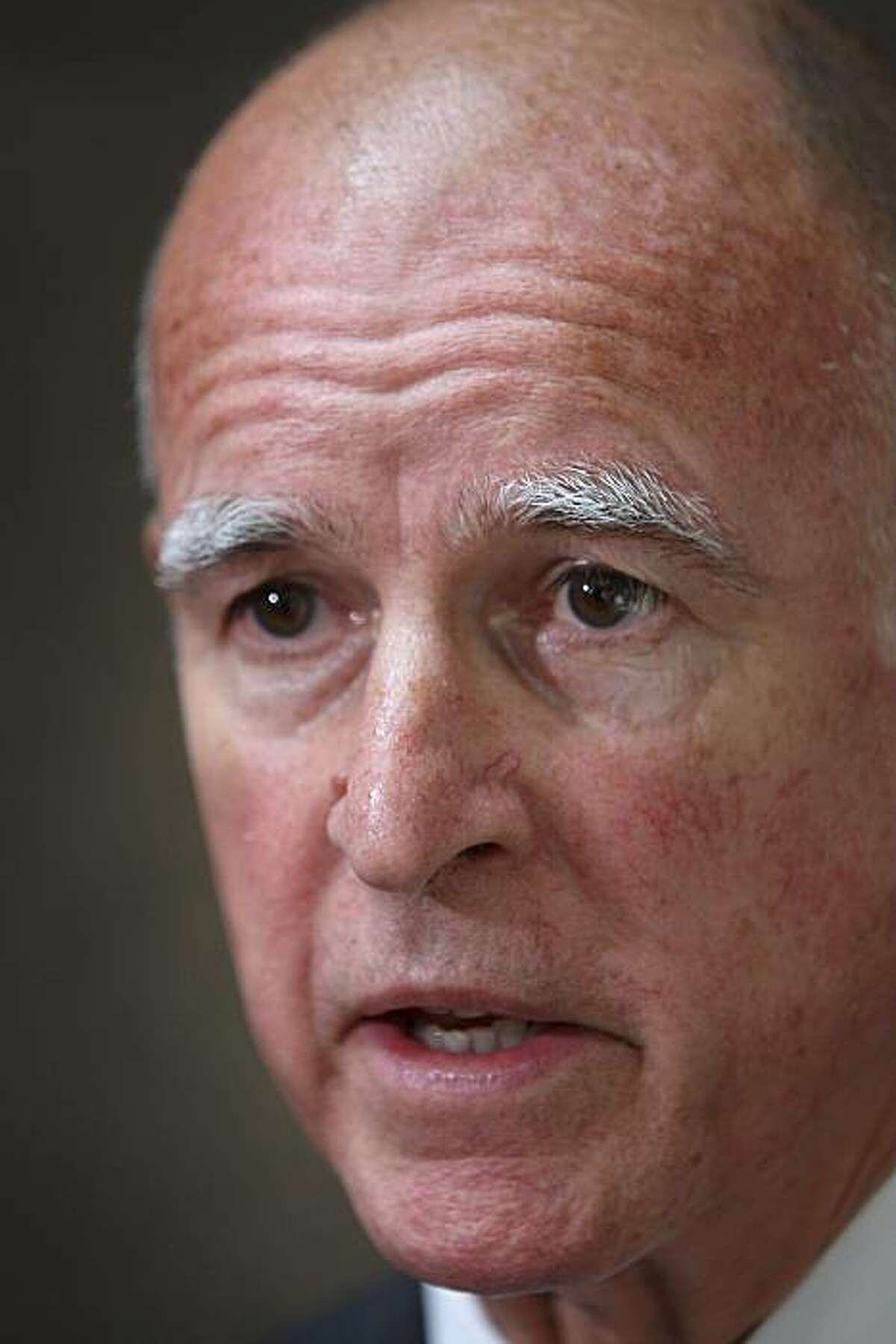 (FILES): This September 15, 2009 file photo shows California Attorney General Jerry Brown addressing a press conference in Los Angeles, California when he announced a Web-based prescription drug database to track all controlled substances prescribed in California. Brown on March 2, 2010 formally entered the race to replace Arnold Schwarzenegger as governor, confirming a candidacy which had been widely forecast for months. Brown, 71, who served two terms as California governor from 1975 to 1983, announced his intention to run as the Democratic candidate in a video message on his website, where he vowed to clean up the state's fiscal problems. Files/David McNew/Getty Images/AFP == FOR NEWSPAPERS, INTERNET, TELCOS & TELEVISION USE ONLY == (Photo credit should read DAVID MCNEW/AFP/Getty Images)