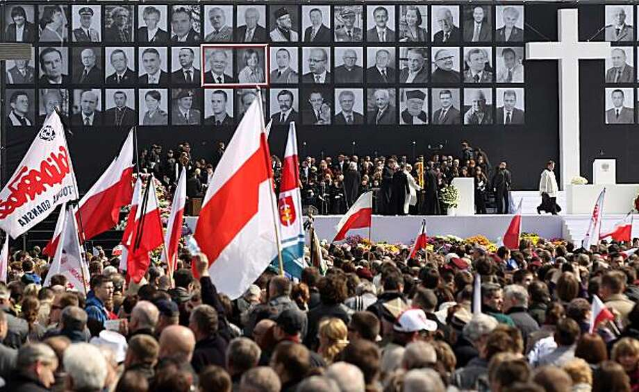 WARSAW, POLAND - APRIL 17:  Mourners bear flags and standards while attending a memorial service for late Polish President Lech Kazcynski, his wife Maria and the 94 other people killed in the recent Polish presidential plane crash in Smolensk at a memorial service at Pilsudski Square on April 17, 2010 in Warsaw, Poland. Polish President Lech Kaczynski, his wife Maria and leading members of the Polish military, government and the arts were killed when the presidential plane they were traveling in crashed while attempting to land at Smolensk, Russia, on April 10. A memorial service for those killed is being held today and the state funeral for the Kaczysnkis is to be held at Wawel Castle in Cracow on Sunday. Photo: Sean Gallup, Getty Images