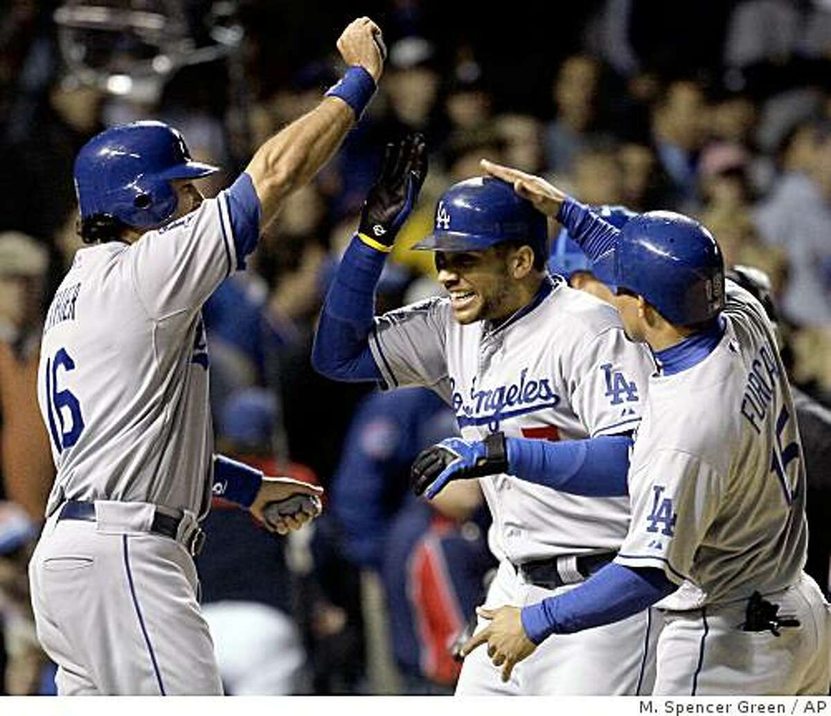 Los Angeles Dodgers' James Loney, center, is congratulated by teammates Andre Ethier (16) and Rafael Furcal, right, after hitting a grand slam during fifth-inning baseball action in Game 1 of the National League division series against the Chicago Cubs, Wednesday, Oct. 1, 2008, in Chicago. (AP Photo/M. Spencer Green)