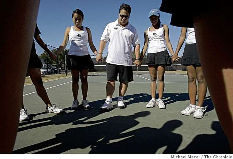 Jason Scalese is the coach of the girls varsity tennis team of Archbishop Mitty HIgh School in San Jose, Calif, Scalese leads a prayer with his players before a match against St. Ignatius, on Tuesday Sept. 23, 2008. Photo: Michael Macor, The Chronicle