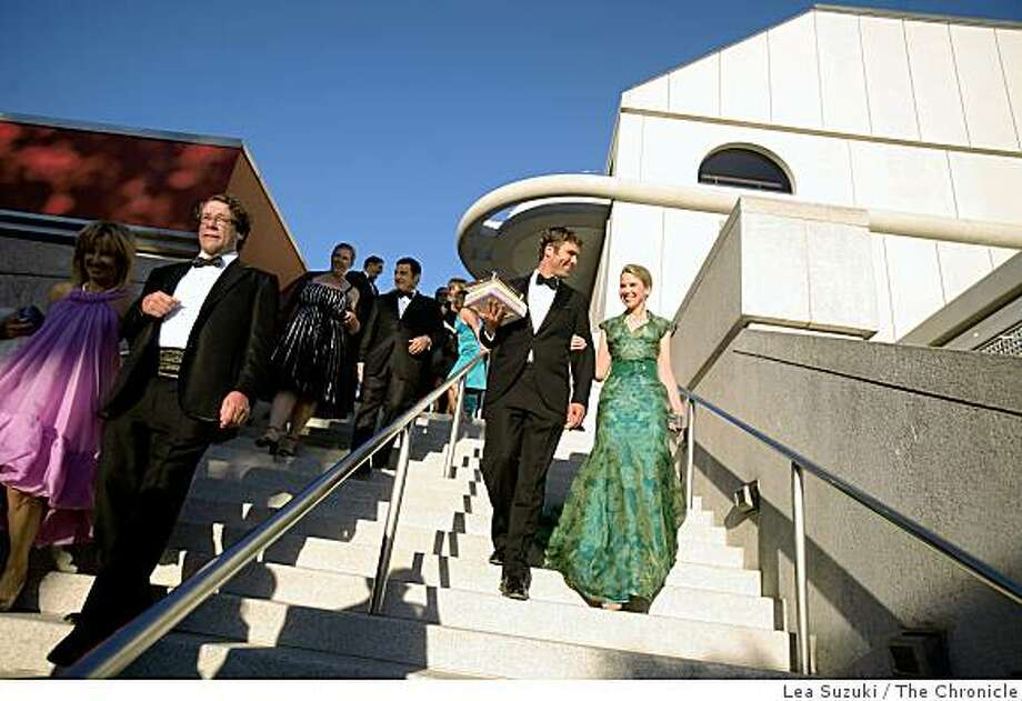 Marissa Mayer (right in green) and Zachary Bogue (second from right) at Davies Symphony Hall for the Symphony gala opening head to the patrons' dinner tent on Wednesday September 3, 2008 in San Francisco, Calif. Photo: Lea Suzuki, The Chronicle