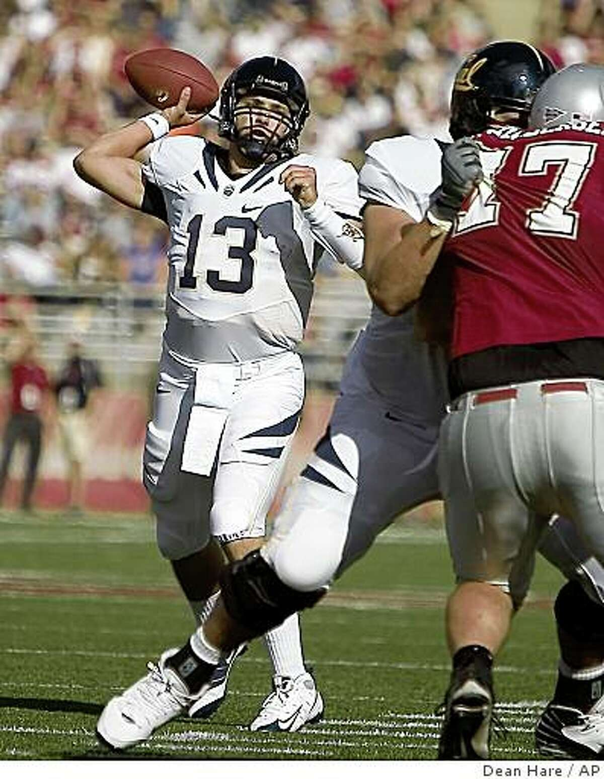 California quarterback Kevin Riley (13) throws a touchdown pass to Sean Young as center Alex Mack blocks Washington State tackle Matt Eichelberger (77) in the first quarter of an NCAA college football game Saturday, Sept. 6, 2008, at Martin Stadium in Pullman, Wash. (AP Photo/Dean Hare)