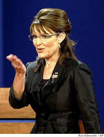 Republican vice presidential candidate Alaska Gov. Sarah Palin blows a kiss as she steps on stage before the vice presidential debate at Washington University in St. Louis, Mo., Thursday, Oct. 2, 2008.  (AP Photo/Ron Edmonds) Photo: Ron Edmonds, AP
