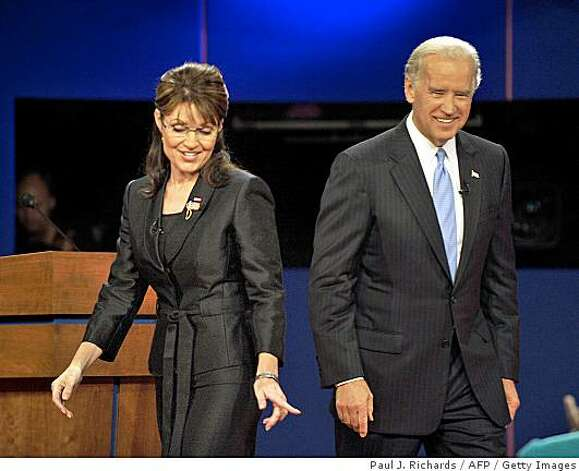 Republican Sarah Palin (L) and Democrat Joseph Biden (R) walk on stage following their vice presidential debate on October 2, 2008 at Washington University in St. Louis, Missouri. Photo: Paul J. Richards, AFP / Getty Images