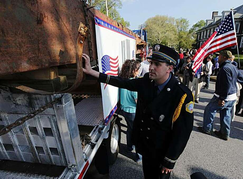 ** RE-TRANS WITH ALTERNATE CROP ** A Downingtown Pa., firefighter touches a steel beam salvaged from the World Trade Center arrive in Coatesville, Pa., Wednesday, April 14, 2010. Officials hope to use the steel as the centerpiece of an industrial historymuseum. Photo: Matt Rourke, AP