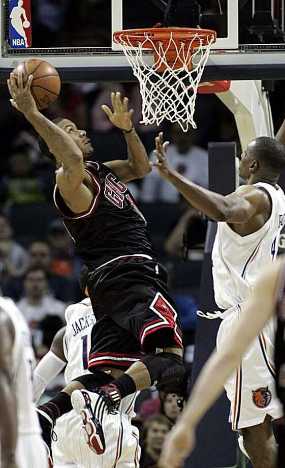 Chicago Bulls guard Derrick Rose, left, shoots over Charlotte Bobcats center Theo Ratliff in the second half of an NBA basketball game Wednesday, April 14, 2010, in Charlotte, N.C. Rose scored 27 points as Chicago won 98-89. Photo: Nell Redmond, AP