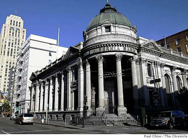 The long-neglected and vacant Hibernia Bank building on McAllister Street near Market Street is seen in San Francisco, Calif., on Friday, April 25, 2008. Millions of dollars of redevelopment funds earmarked to spruce up the neighborhood has been tied up in political limbo and may go to waste. Photo: Paul Chinn, The Chronicle