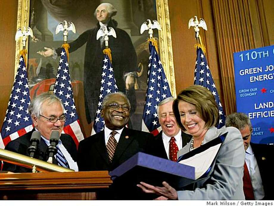 WASHINGTON - OCTOBER 03:  House Speaker Nancy Pelosi (D-CA) holds up the HR1424 Financial Rescue package bill she just signed while House Financial Services Committee Chairman Barney Frank (D-MA) (L), James E. Clyburn (D-SC) (2nd-L), House Mahority Leader Steny Hoyer (D-MD) and Rep. Rahm Emanuel (R-IL) (R) stand nearby on Capitol Hill October, 3, 2008 in Washington, DC. Moments earlier the House of Representatives passed the revised version of the financial rescue package that failed to pass on Monday.  (Photo by Mark Wilson/Getty Images) Photo: Getty Images