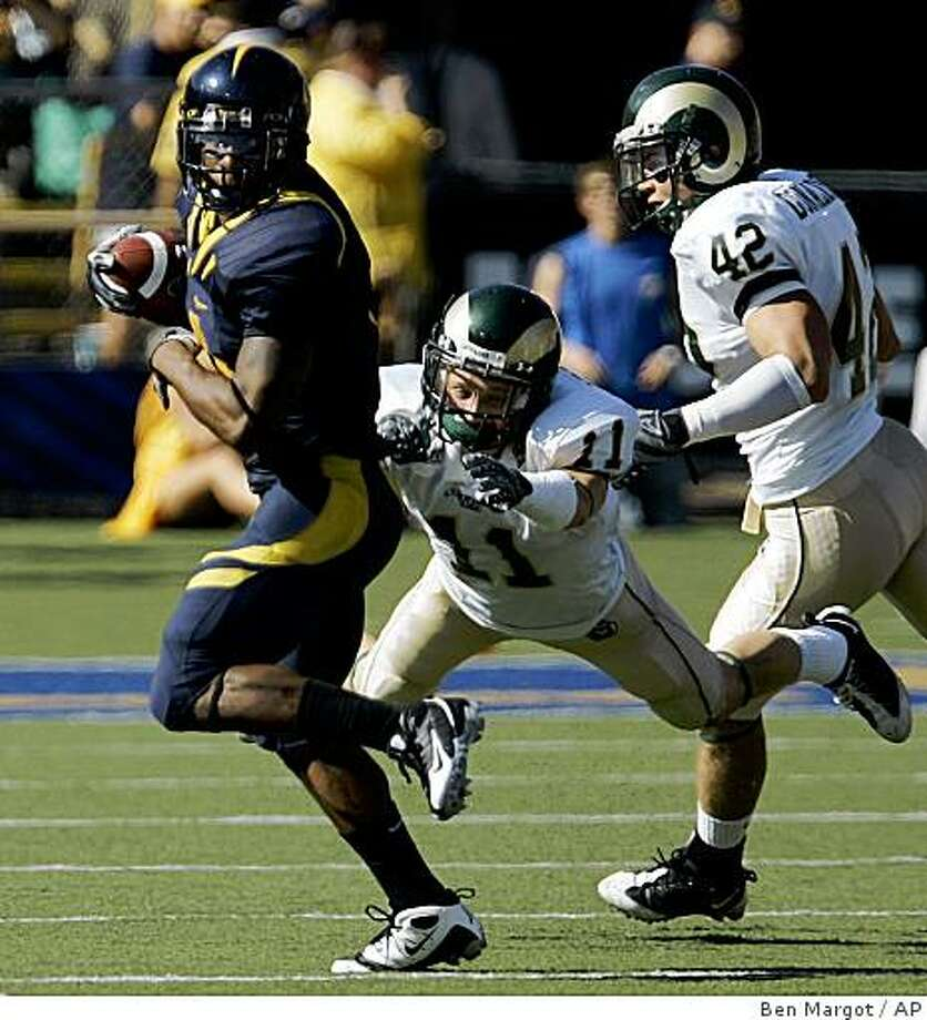California running back Jahvid Best, left, breaks the tackle of Colorado State cornerback Nick Oppenneer (11) and safety Zach Donaldson in the first half of an NCAA college football game Saturday, Sept. 27, 2008, in Berkeley, Calif. (AP Photo/Ben Margot) Photo: Ben Margot, AP