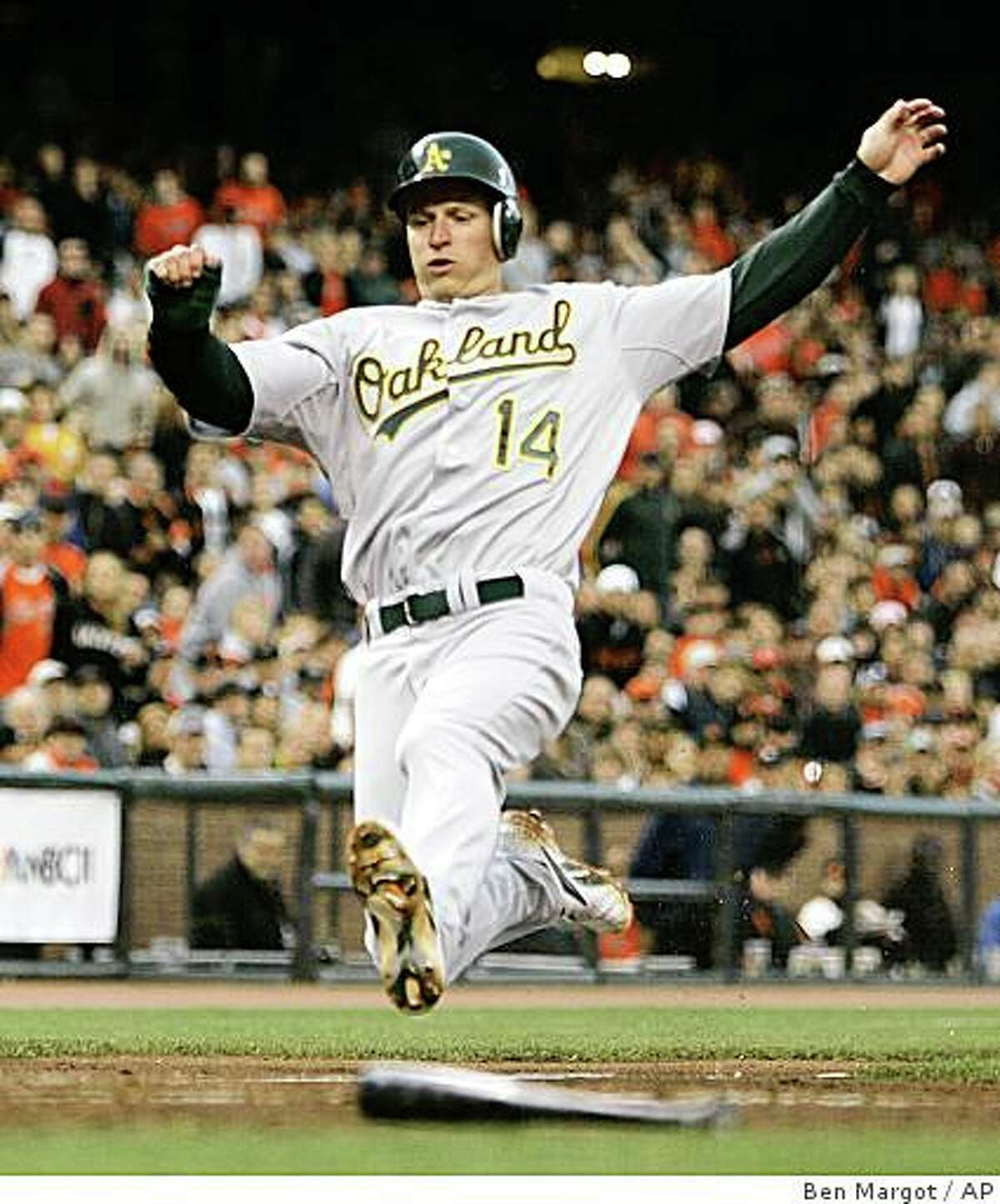 Oakland Athletics' Mark Ellis slides to score during the third inning of a baseball game against the San Francisco Giants Friday, June 13, 2008, in San Francisco. Ellis scored on a sacrifice fly by Jack Cust. (AP Photo/Ben Margot)