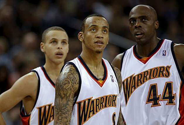 Golden State Warriors' Stephen Curry (30), Monta Ellis (8) and Anthony Tolliver (44) watch during a timeout as they fall to the Charlotte Bobcats at Oracle Arena  in Oakland,Calif. Photo: Michael Macor, The Chronicle
