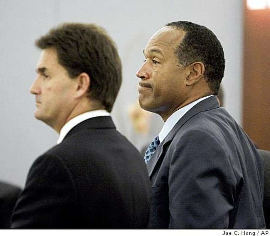 O.J. Simpson, right, and his attorney Yale Galanter listen during closing arguments in his trial at the Clark County Regional Justice Center Thursday, Oct. 2, 2008, in Las Vegas. Simpson is charged with twelve counts including kidnapping, armed robbery and assault with a deadly weapon stemming from an alleged incident involving the theft of his sports memorabilia. (AP Photo/ Jae C. Hong, Pool) Photo: Jae C. Hong, AP
