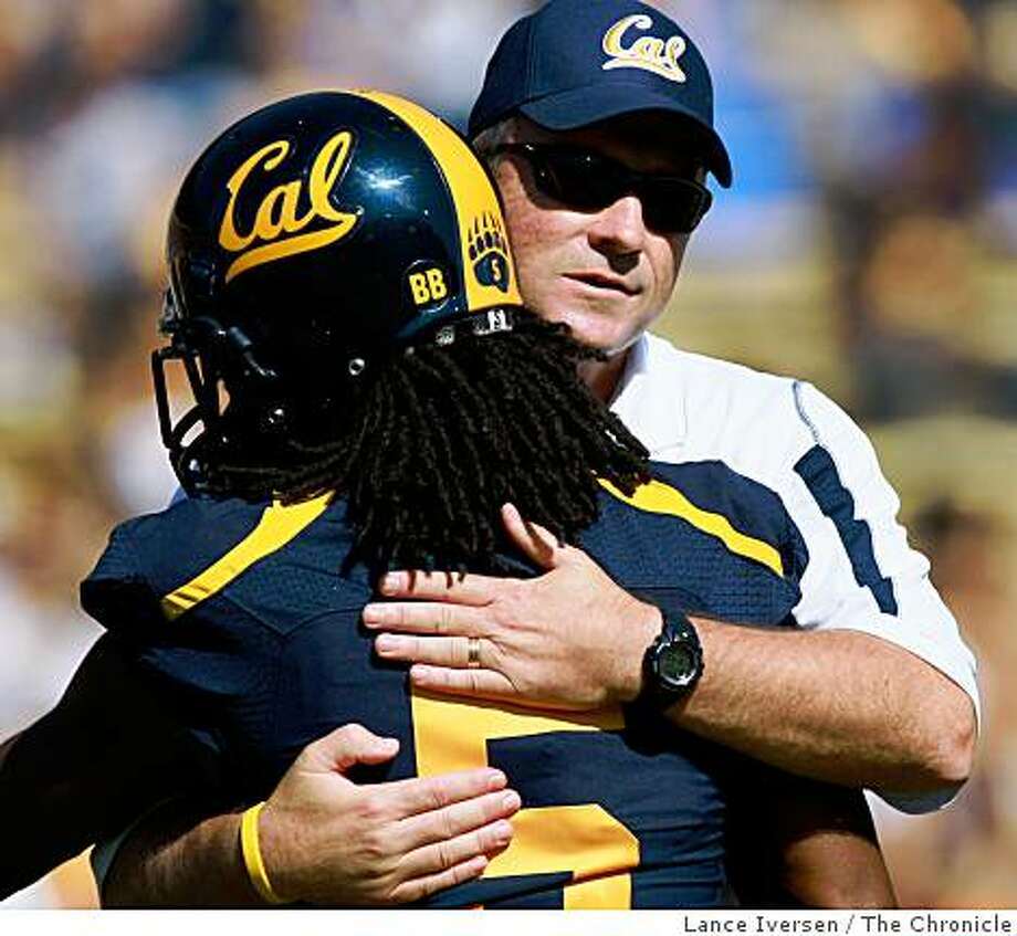 Syd'Quan Thompson gets a hug from head coach Jeff Tedford prior to their game with Colorado State. Cal defeated Colorado 42-7 September 27,  2008 in Berkeley. Photo: Lance Iversen, The Chronicle