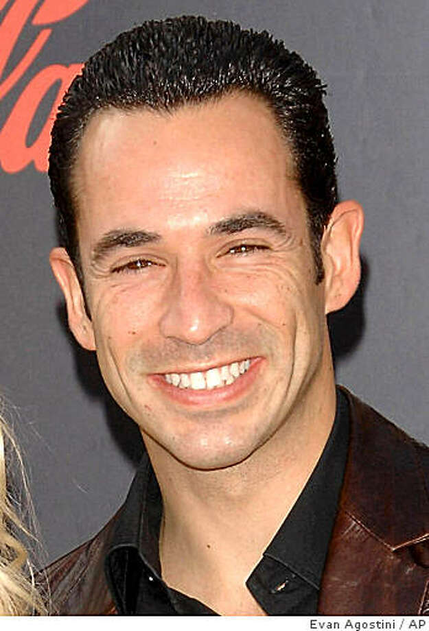 ** FILE ** In this Nov. 18, 2007 file photo, Helio Castroneves arrives at the American Music Awards in Los Angeles. A grand jury on Thursday, oct. 2, 2008, returned a tax evasion indictment against the 33-year-old Castroneves, who lives in a Coral Gables mansion.  (AP Photo/Evan Agostini, file) Photo: Evan Agostini, AP