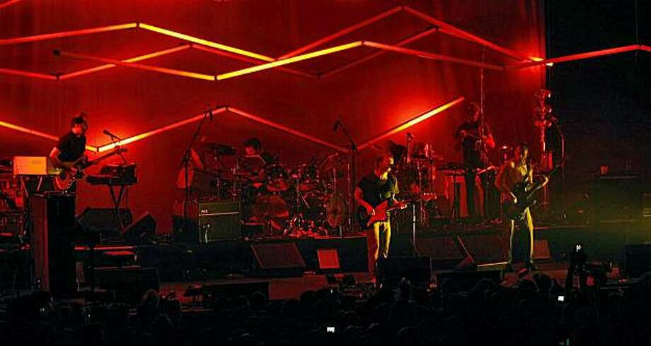The new funky band called Atoms For Peace performs, Wednesday April 14, 2010, at the Fox Theater in Oakland, Calif.  The group includes lead singer from Radioheads Thom Yorke, Flea from the Red Hot Chili Peppers  on bass, Radiohead's producer, Joey Waronker from Beck's band on drums; and Mauro Refosco, who plays with David Byrne, on percussion. Photo: Lacy Atkins, The Chronicle
