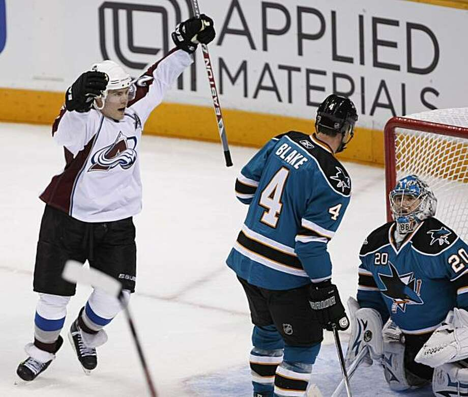 Colorado Avalanche defenseman Scott Hannan, left, celebrates after right wing Chris Stewart, not shown, scored past San Jose Sharks goalie Evgeni Nabokov (20) and defenseman Rob Blake (4) in the last minute of the third period of Game 1 of a first-round NHL hockey playoff series Wednesday, April 14, 2010, in San Jose, Calif. Colorado Avalanche defeated the San Jose Sharks 2-1. Photo: Paul Sakuma, AP