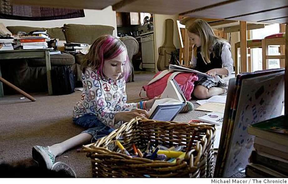 Emma, 12 and her sister, Gillian, 8,  busy with home work after school at their San Francisco, Calif. apartment, Tuesday  Sept. 16, 2008, Emma is paralyzed. Photo: Michael Macor, The Chronicle