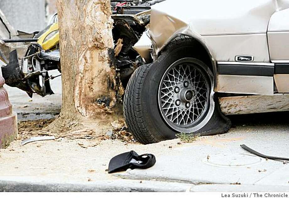 A baseball hat lies on the ground near the wheel of the car which caused an accident on Mission Street where one pedestrian was fatally injured when hit by the vehicle on Monday, September 29, 2008 in San Francisco, Calif. Photo: Lea Suzuki, The Chronicle