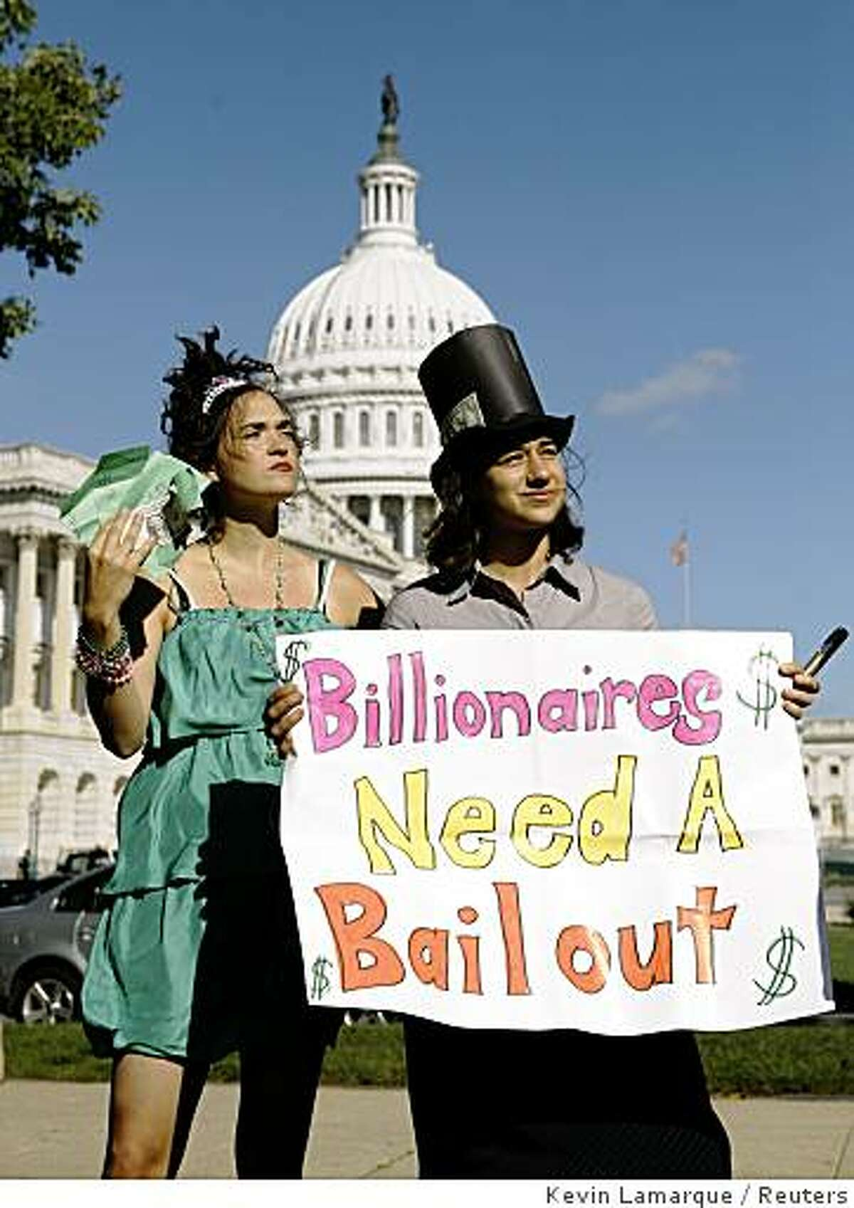 Protesters perform a skit mocking the economic bailout plan in front of the Capitol building in Washington October 2, 2008. The House is expected to vote Friday on the $700 billion financial rescue plan which was passed by the Senate last night. REUTERS/Kevin Lamarque (UNITED STATES)
