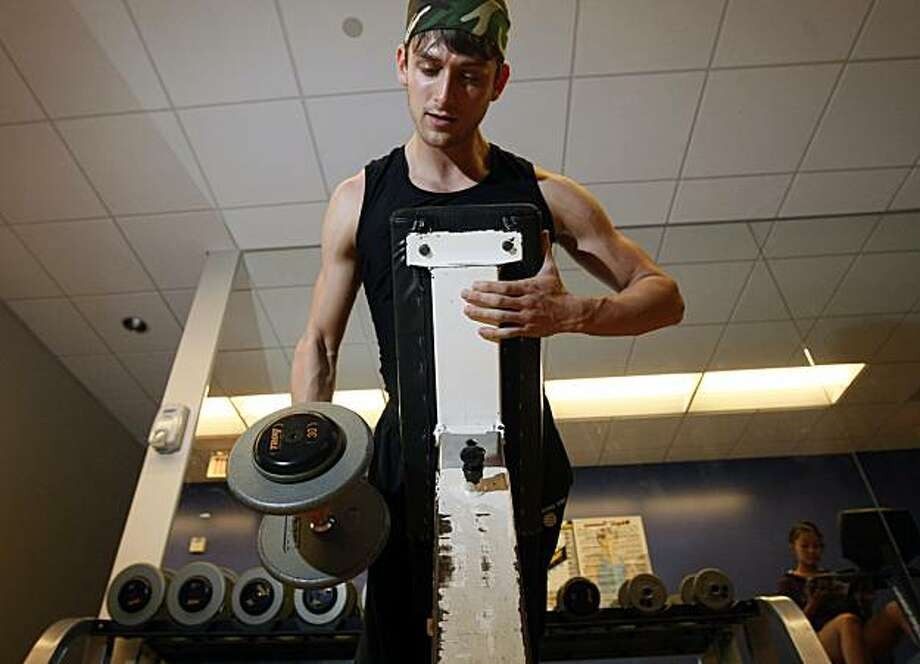 Garen Scribner is a San Francisco Ballet soloist with a major role in the Little Mermaid. Scribner prepares himself daily by lifting weights several hours before performance along with Stretching exercises in the San Francisco Ballet wellness center.  Wednesday March 24, 2010. Photo: Lance Iversen, The Chronicle