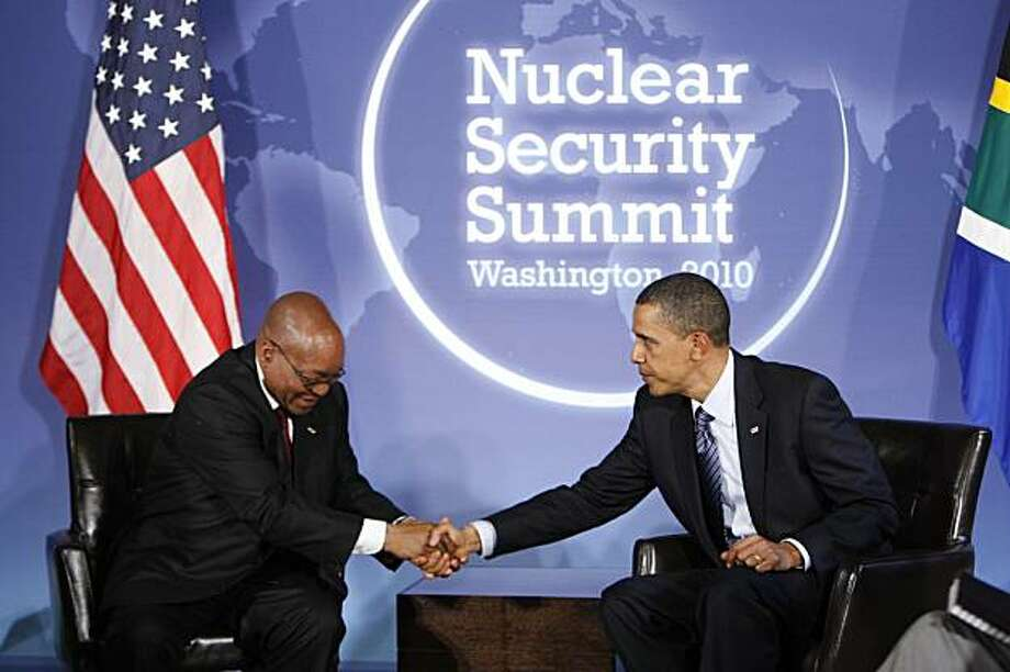 President Barack Obama, right, shakes hands with South Africa's President Jacob Zuma, left, during their meeting in advance of the Nuclear Security Summit, at Blair House in Washington, Sunday, April 11, 2010. Photo: Pablo Martinez Monsivais, AP
