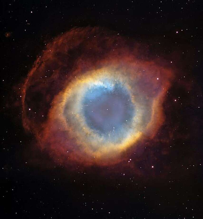 """A composite image of the colorful Helix Nebula taken with the Hubble Space Telescope's Advanced Camera for Surveys and the Mosaic II Camera on the 4-meter telescope at Cerro Tololo Inter-American Observatory in Chile. This undated image is featured in the new Warner Bros. Pictures production """"Hubble 3D"""" narrated by Leonardo DiCaprio, in cooperation with the NASA. Photo: Nasa"""