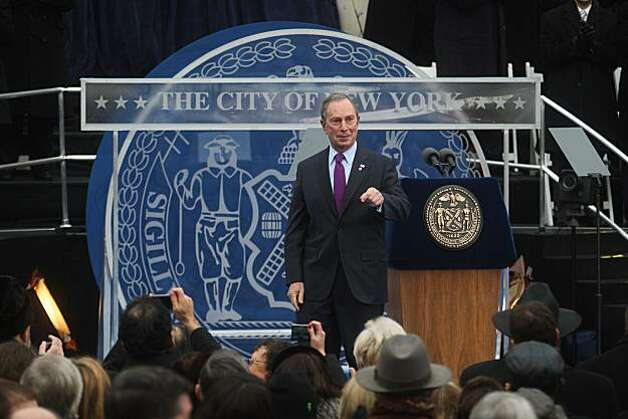 NEW YORK - JANUARY 1:  New York Mayor Michael Bloomberg acknowledges the crowd after taking the oath of office administered by New York State Chief Judge Jonathan Lippman January 1, 2010 at City Hall in New York City. Bloomberg launched his third term in office. (Photo by Hiroko Masuike/Getty Images) Photo: Hiroko Masuike, Getty Images