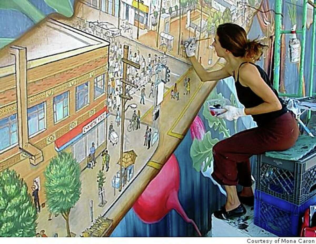 Muralist Mona Caron puts the finishing touches on one of two new murals in Noe Valley.