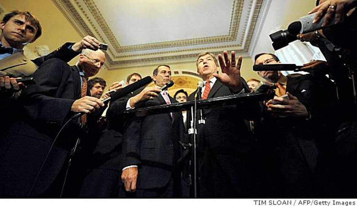 US House Minority Leader John Boehner (L)(R-OH) and Rep. Roy Blunt (R)(R-MO) make remarks to the press after the financial bailout package failed in a vote before the House of Representatives September 29, 2008 in Washington, DC. The House rejected the $700 billion rescue package, 228-205, after a weekend of intense negotiation. The Dow Jones Industrial Average plunged 700 points -- one of its biggest drops ever -- on the news and then swung wildly as investors tried to gauge the next step for the plan and the financial sector. AFP PHOTO TIM SLOAN (Photo credit should read TIM SLOAN/AFP/Getty Images)