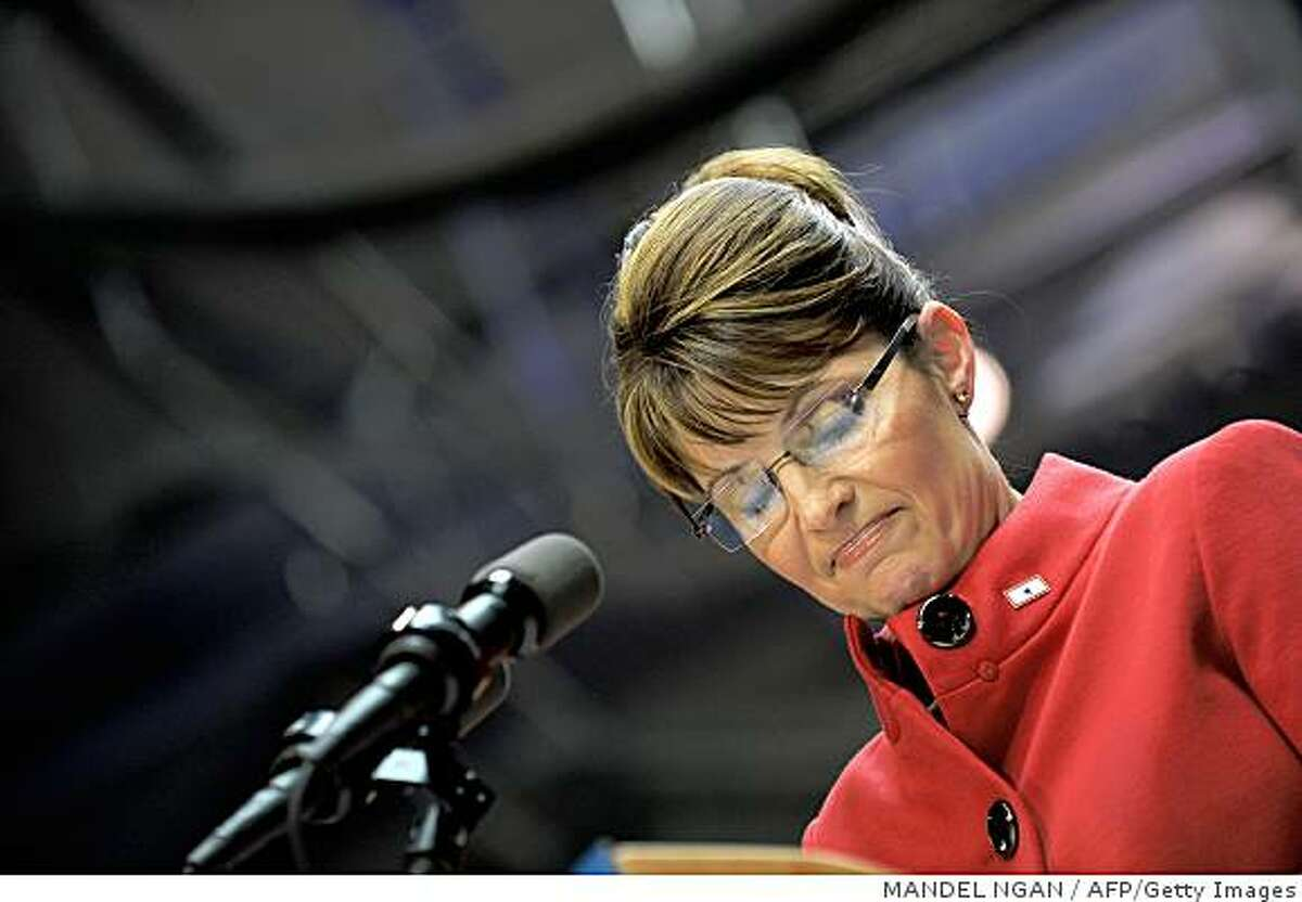 Republican vice presidential nominee Alaska Governor Sarah Palin looks down as she speaks during a rally September 29, 2008 at Capital University in Columbus, Ohio.AFP PHOTO/Mandel NGAN (Photo credit should read MANDEL NGAN/AFP/Getty Images)