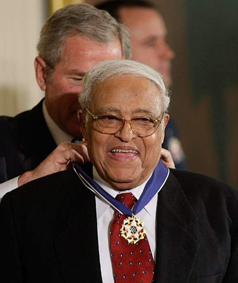 FILE - In this Nov. 5, 2007 file photo, President Bush, left, presents the Presidential Medal of Freedom to Civil Rights pioneer Benjamin Hooks, during a ceremony in the East Room of the White House in Washington. Hooks, a champion of minorities and the poor whose longtime tenure as executive director of the NAACP included leading his organization through a deadly firebombing campaign that targeted his group, died early Thursday said State Rep. Ulysses Jones. He was 85. Photo: Ron Edmonds, AP