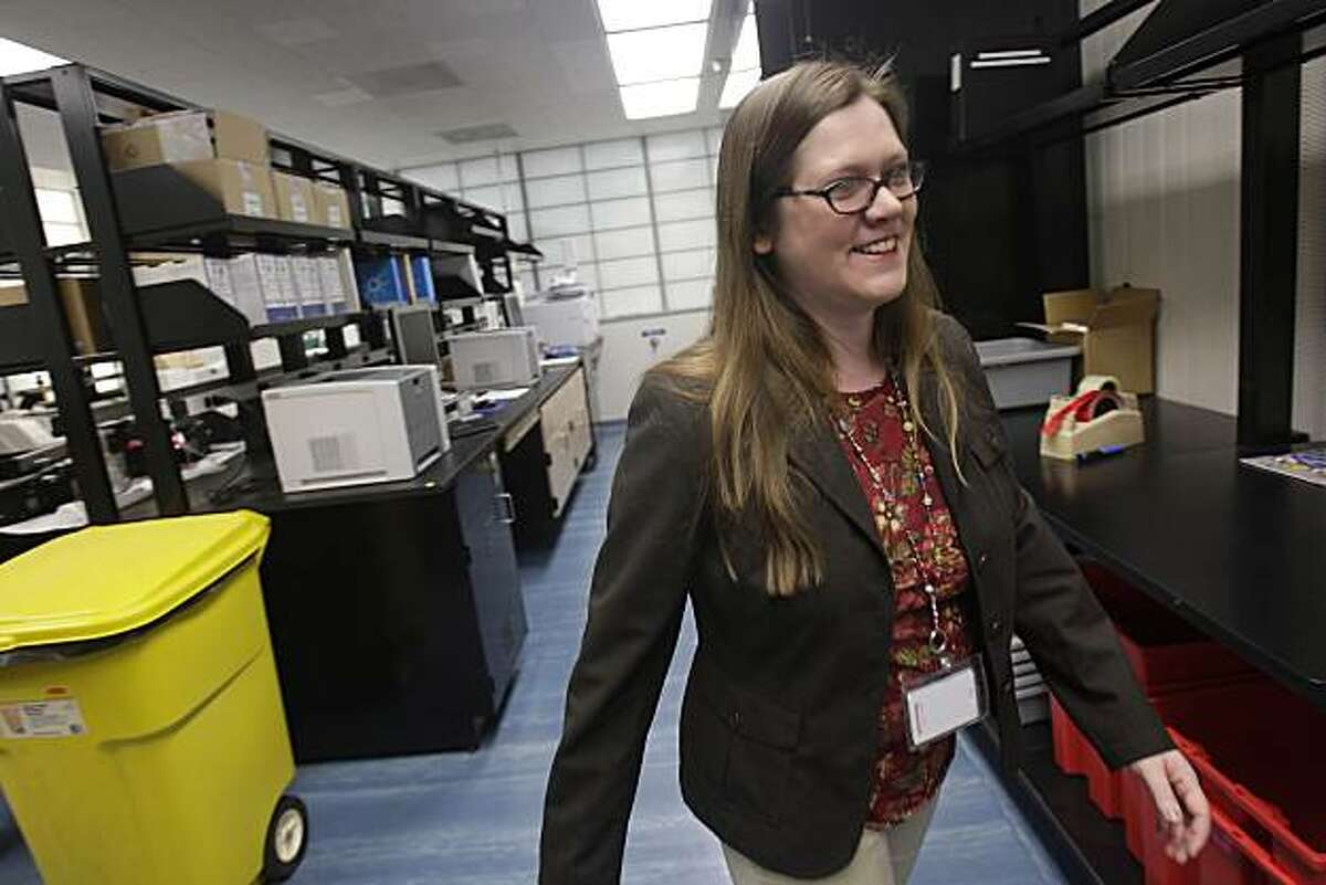 Lois Woodworth, supervisor of controlled substances, walks through the narcotics/chemical analysis unit during a media tour of the Crime Lab in San Francisco, Calif. on Wednesday, March 10, 2010.