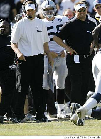 Raiders head coach Lane Kiffin (left) watches the game on the sidelines during the Oakland Raiders vs San Diego Chargers game on Sunday, September 28, 2008 in Oakland, Calif. Photo: Lea Suzuki, The Chronicle