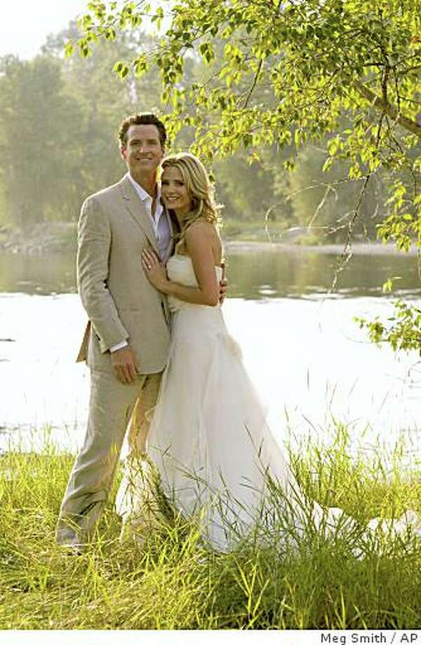San Francisco Mayor Gavin Newsom poses with his new wife Jennifer Siebel on the banks of the Bitterroot river Saturday July 26, 2008 shortly after being married on her parents' ranch . Newsom took a break from his busy job and gubernatorial ambitions to marry actress Jennifer Siebel on Saturday at Siebel's parents' Montana ranch. It is the 34-year-old Siebel's first marriage and the second for Newsom, who divorced legal analyst Kimberly Guilfoyle in March 2006. (AP Photo/Meg Smith) Photo: Meg Smith, AP