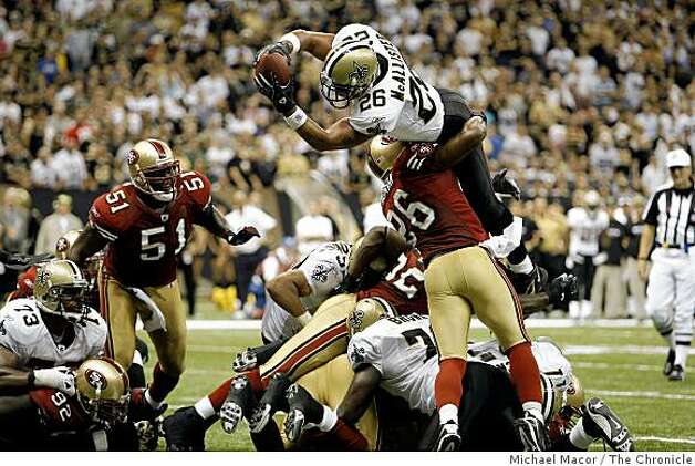 San Francisco 49ers Mark Roman (26) can't keep New Orleans Saints Deuce McAllister (26) out of the end zone as McAllister goes up and over on a 1 yard run in the 3rd quarter to score to make it 28-17as the San Francisco 49ers lose to  the New Orleans Saints final score 31-17 in NFL action at the New Orleans Superdome in New Orleans, La.  on Sunday Sept. 28, 2008. Photo: Michael Macor, The Chronicle