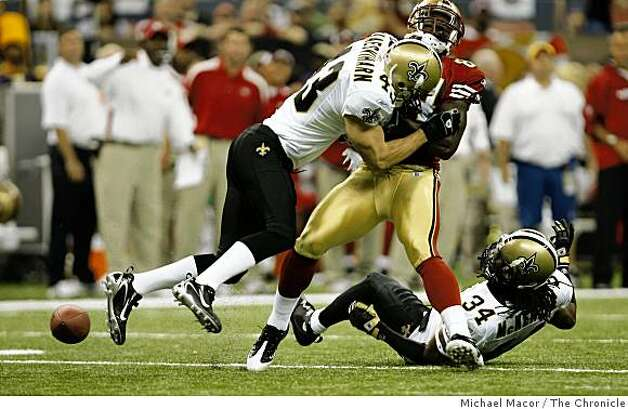 San Francisco 49ers Josh Morgan is hit by New Orleans Saints Kevin Kaesviharn (43) and looses the ball, also covered by New Orleans Saints Mike McKenzie (34) at the New Orleans Superdomein new Orleans, La.  on Sunday Sept.28, 2008. Photo: Michael Macor, The Chronicle