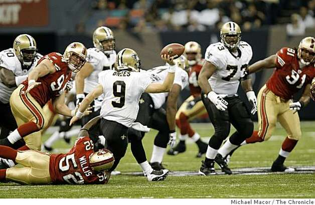 San Francisco 49ers Patrick Willis (52) drags down New Orleans Saints quarterback Drew Brees (9) in the first quarter, as the San Francisco 49ers take on the New Orleans Saints in NFL action at the New Orleans Superdomein new Orleans, La.  on Sunday Sept.28, 2008. Photo: Michael Macor, The Chronicle