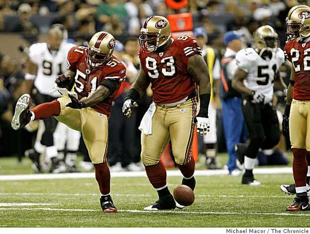 San Francisco 49ers Takeo Spikes (51) celebrates his first quarter intercept as San Francisco 49ers Ronald Fields (93) joins in, as the San Francisco 49ers take on the New Orleans Saints in NFL action at the New Orleans Superdomein new Orleans, La.  on Sunday Sept.28, 2008. Photo: Michael Macor, The Chronicle