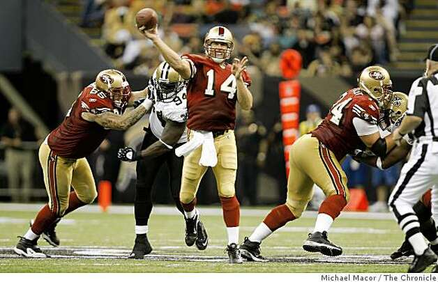 San Francisco 49ers quarterback J.T. O'Sullivan (14) back in the pocket lets a 4th quarter pass fly downfield as the San Francisco 49ers lost to the New Orleans Saints 31-17  in NFL action at the New Orleans Superdome in New Orleans, La.  on Sunday Sept. 28, 2008. Photo: Michael Macor, The Chronicle