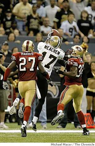 New Orleans Saints Robert Meachem (17) beats San Francisco 49ers Walt Harris (27) and San Francisco 49ers Michael Lewis (32) on a 3rd quarter flee flicker pass as the San Francisco 49ers take on the New Orleans Saints in NFL action at the New Orleans Superdome in New Orleans, La.  on Sunday Sept. 28, 2008. Photo: Michael Macor, The Chronicle