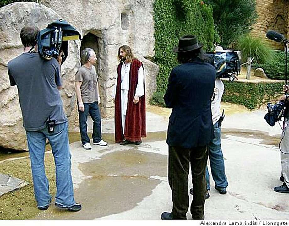 "Bill Maher (background) and Larry Charles (foreground, back to camera) on locaton at The Holy Land Experience in Orlando Fla., during filming of ""Religulous"" 2008. Photo: Alexandra Lambrindis, Lionsgate"