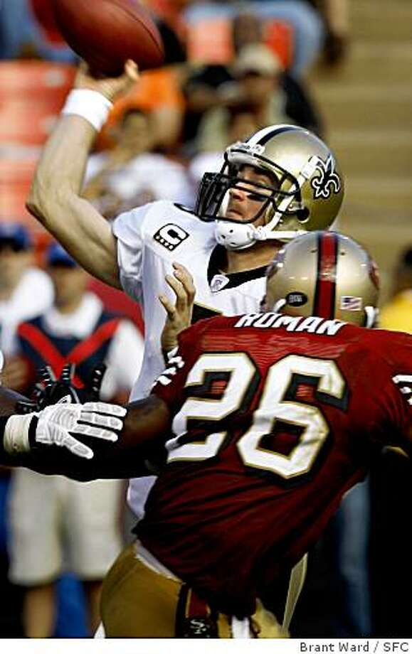 Despite some pressure from Mark Roman, Saints QB Drew Brees completed a short pass in the 3rd quarter. Game action at Monster Park between San Francisco 49ers and New Orleans Saints Sunday. The Saints won 30-10. {By Brant Ward/San Francisco Chronicle}10/28/07 Photo: Brant Ward, SFC