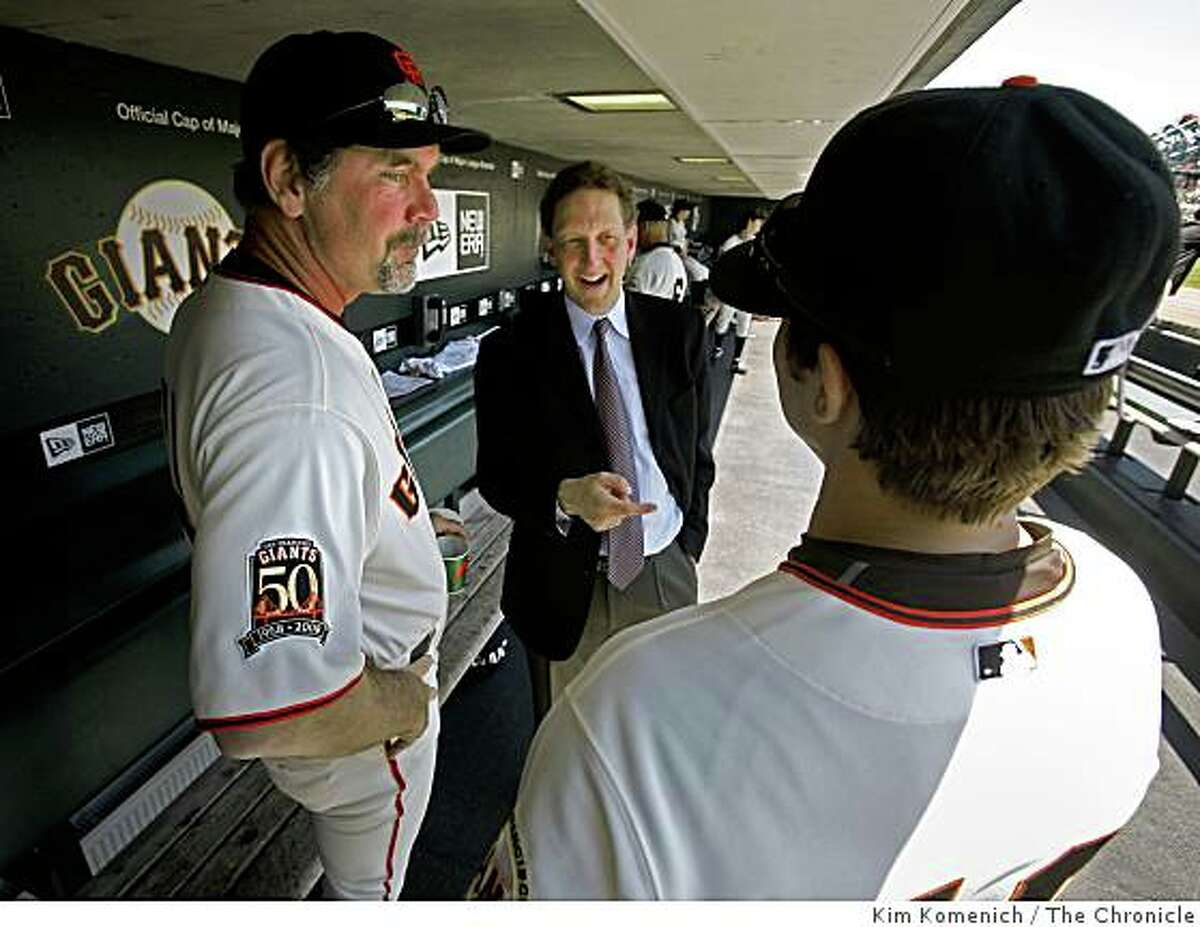 San Francisco Giants Executive Vice President and Chief Operating Officer Larry Baer, center, talks with Giants Manager Bruce Bochy, left and Brian Horwitz, right, at AT&T Park in San Francisco, Calif., on Wednesday, June 4, 2008.Photo by Kim Komenich / The Chronicle