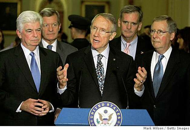 WASHINGTON - OCTOBER 1:  (L-R) Senate Banking Committee Chairman Sen. Chris Dodd (D-CT), Sen. Max Baucus (D-MT), Senate Majority Leader Sen. Harry Reid (D-NV), Sen. Judd Gregg (R-NH) and Senate Minority Leader Mitch McConnell (R-KY) participate in a news conference as the financial rescue bill passed in the Senate at the U.S. Capitol October 1, 2008 in Washington, DC. The U.S. Senate passed the revised version of the financial rescue plan that failed to pass in the House of Representatives on September 29.  (Photo by Mark Wilson/Getty Images) Photo: Mark Wilson, Getty Images