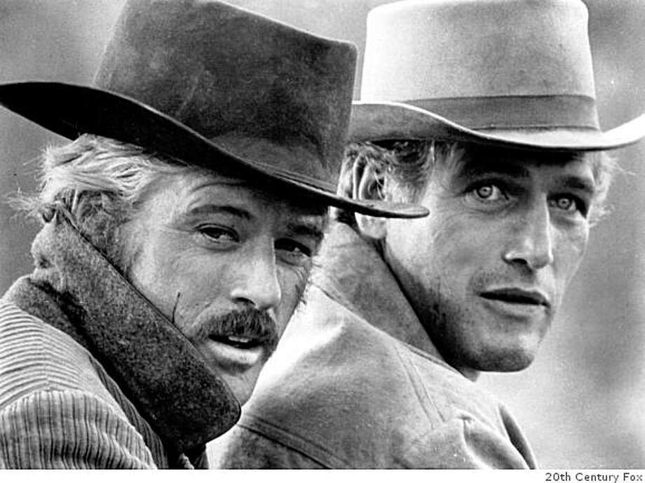 In in this 1969 file photo, actors Robert Redford, left, as the Sundance Kid and Paul Newman as Butch Cassidy appear in this scene from the film ''Butch Cassidy and the Sundance Kid.'' Spokeswoman for Paul Newman says, Saturday, Sept. 27, 2008, that the screen legend has died at age 83 after battling cancer. Photo: 20th Century Fox