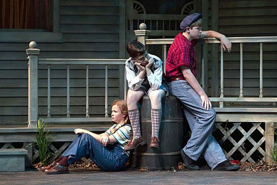 "Scout Finch (Sierra Stephens, left) waits with her friend Dill (Gabriel Hoffman) and her brother Jem (Eric Colvin) for Atticus to come home in TheatreWorks' production of ""To Kill a Mockingbird"" Photo: Mark Kitaoka"